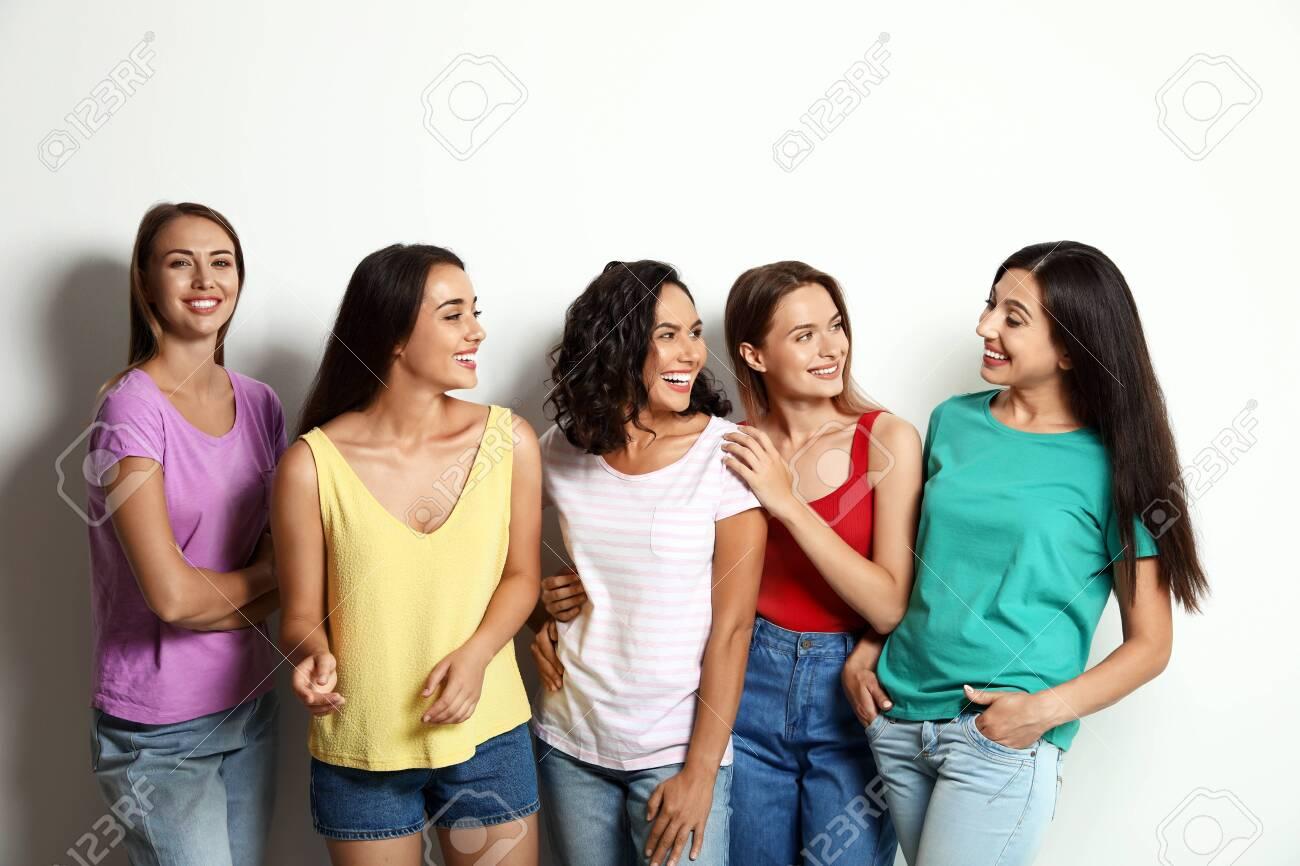 Happy women on white background. Girl power concept - 130496750