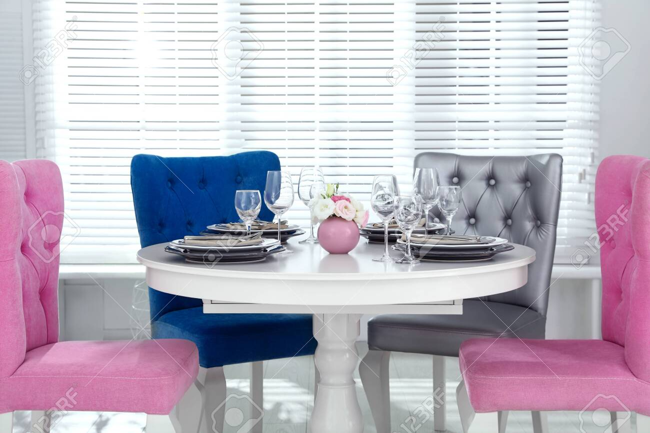 Elegant dining room interior with stylish chairs and table - 130624999