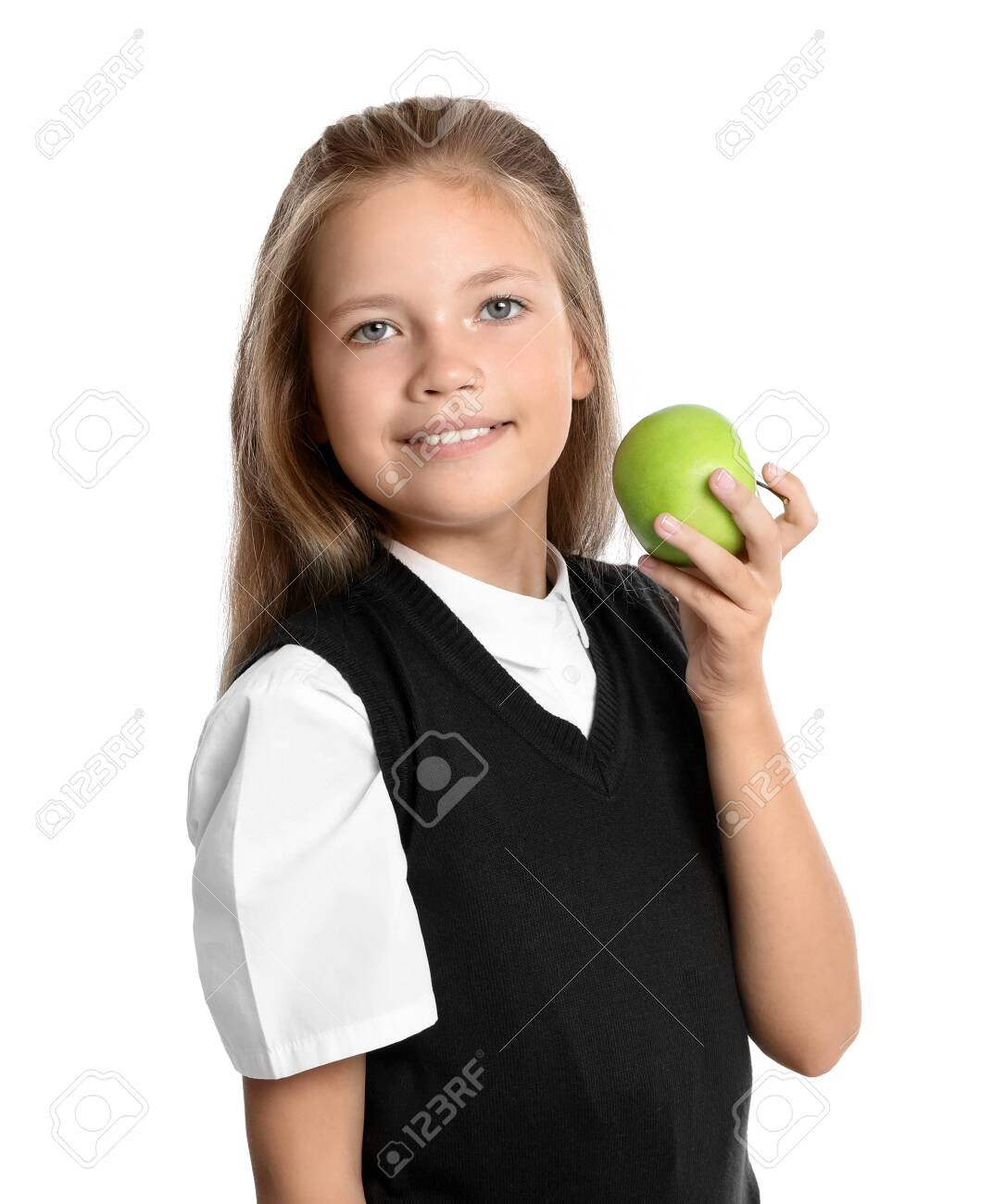 Happy girl with apple on white background. Healthy food for school lunch - 132914415