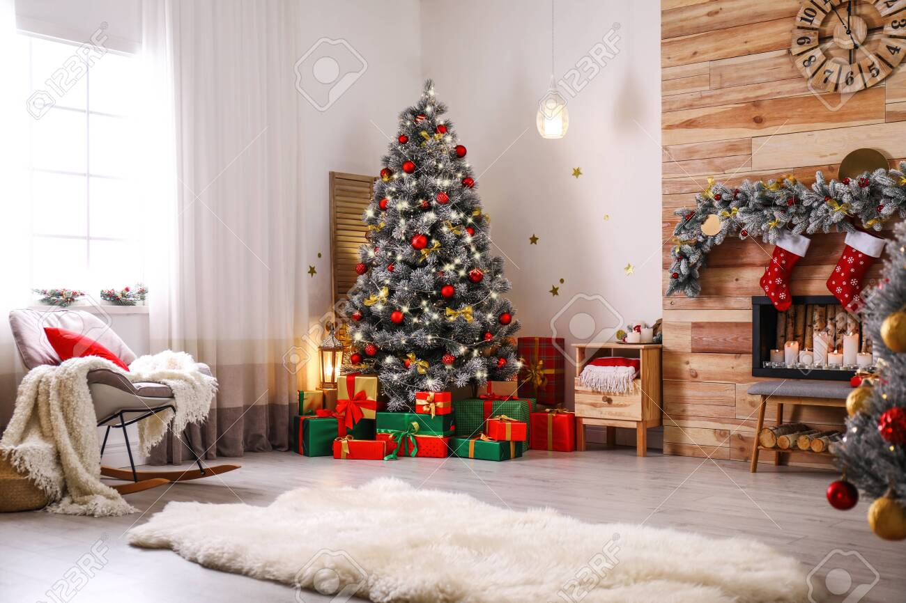 Stylish room interior with beautiful Christmas tree and decorative fireplace - 131456215
