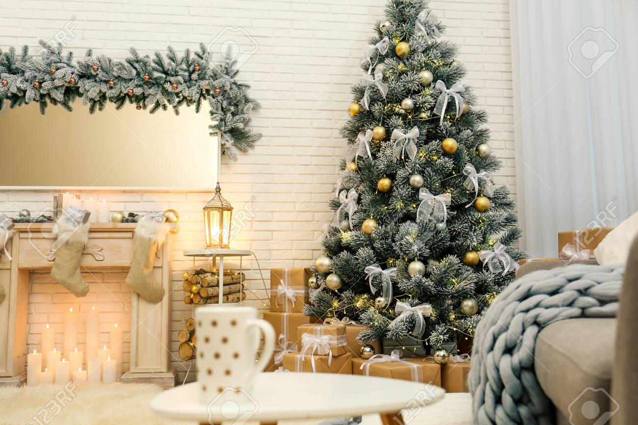 Decorated Christmas tree in modern living room interior - 131219091