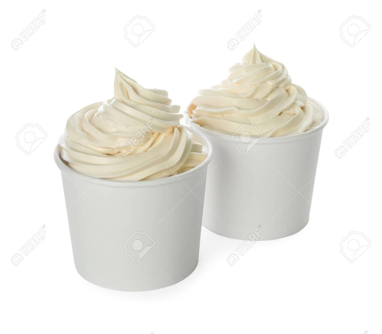 Cups with tasty frozen yogurt on white background - 131578134