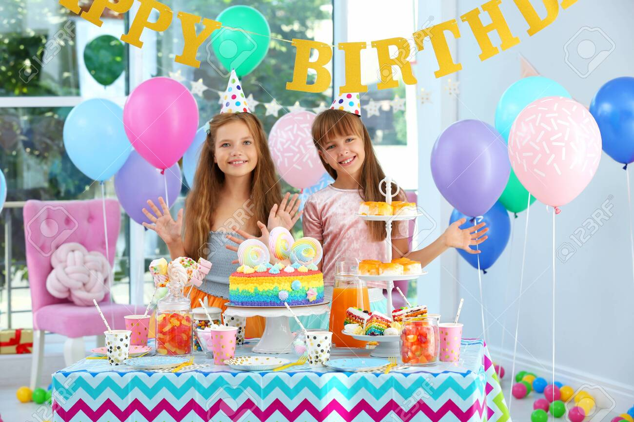 Happy children at birthday party in decorated room - 132002768