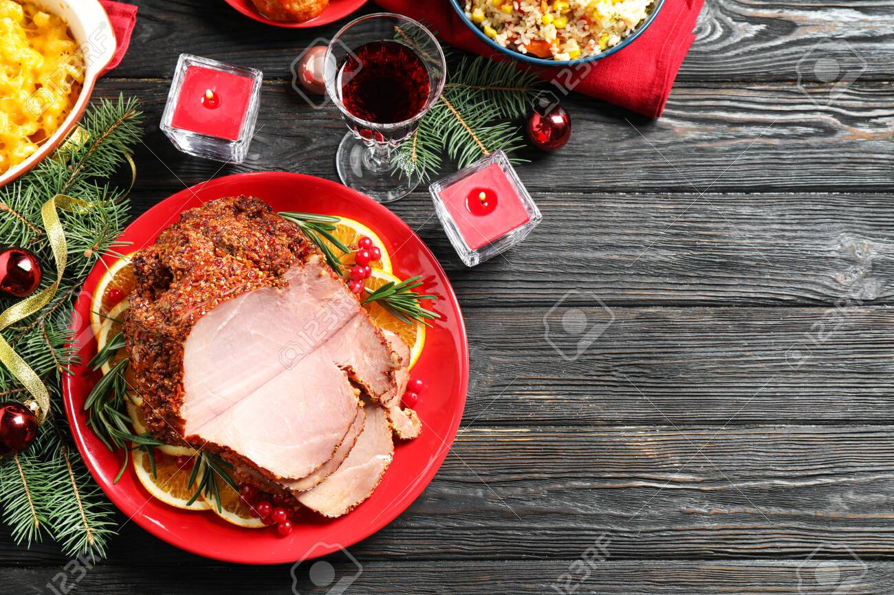 Flat lay composition with delicious ham served on dark wooden table, space for text. Christmas dinner - 132291005