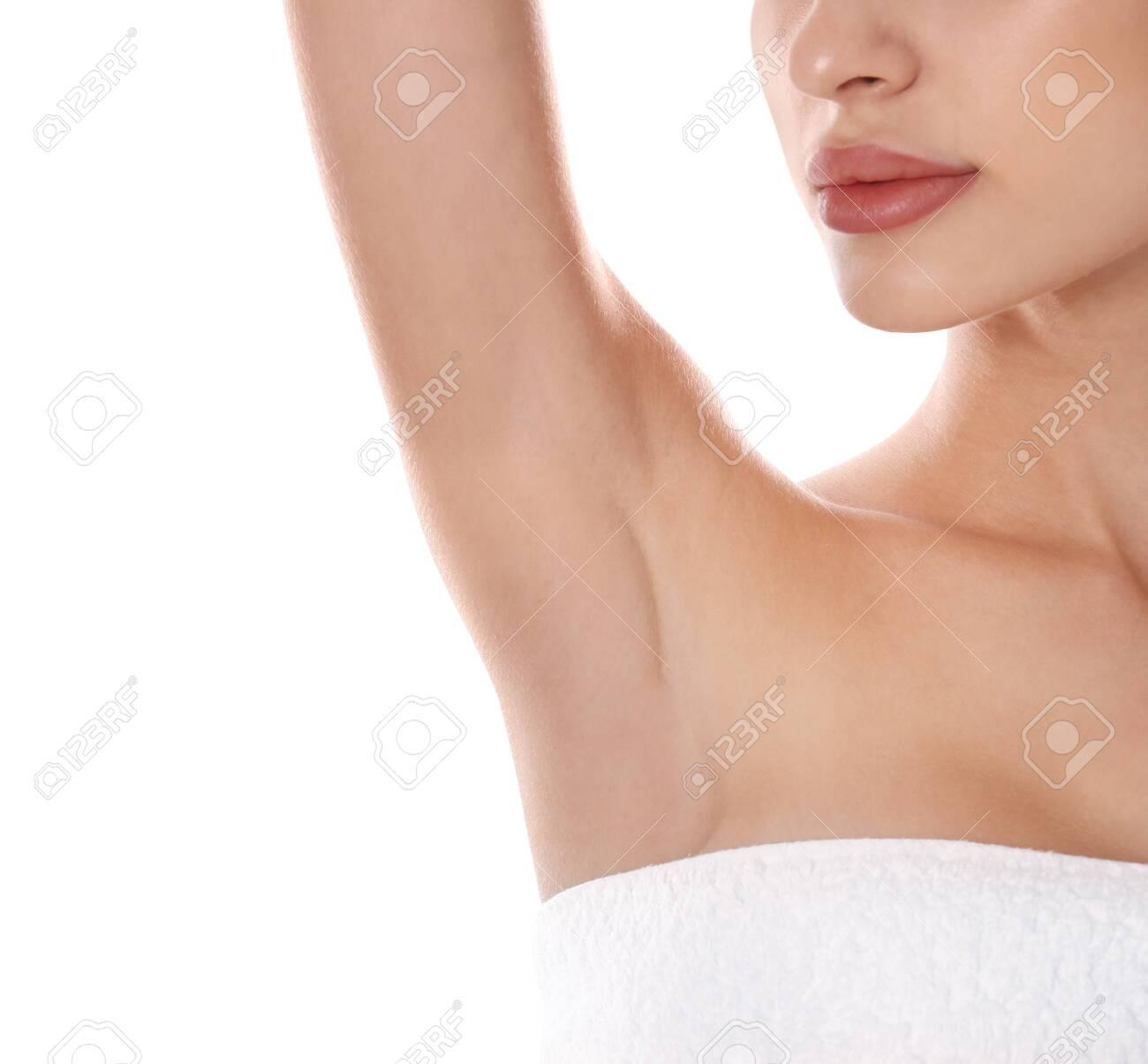 Young woman showing armpit on white background, closeup. Epilation procedure - 132762128