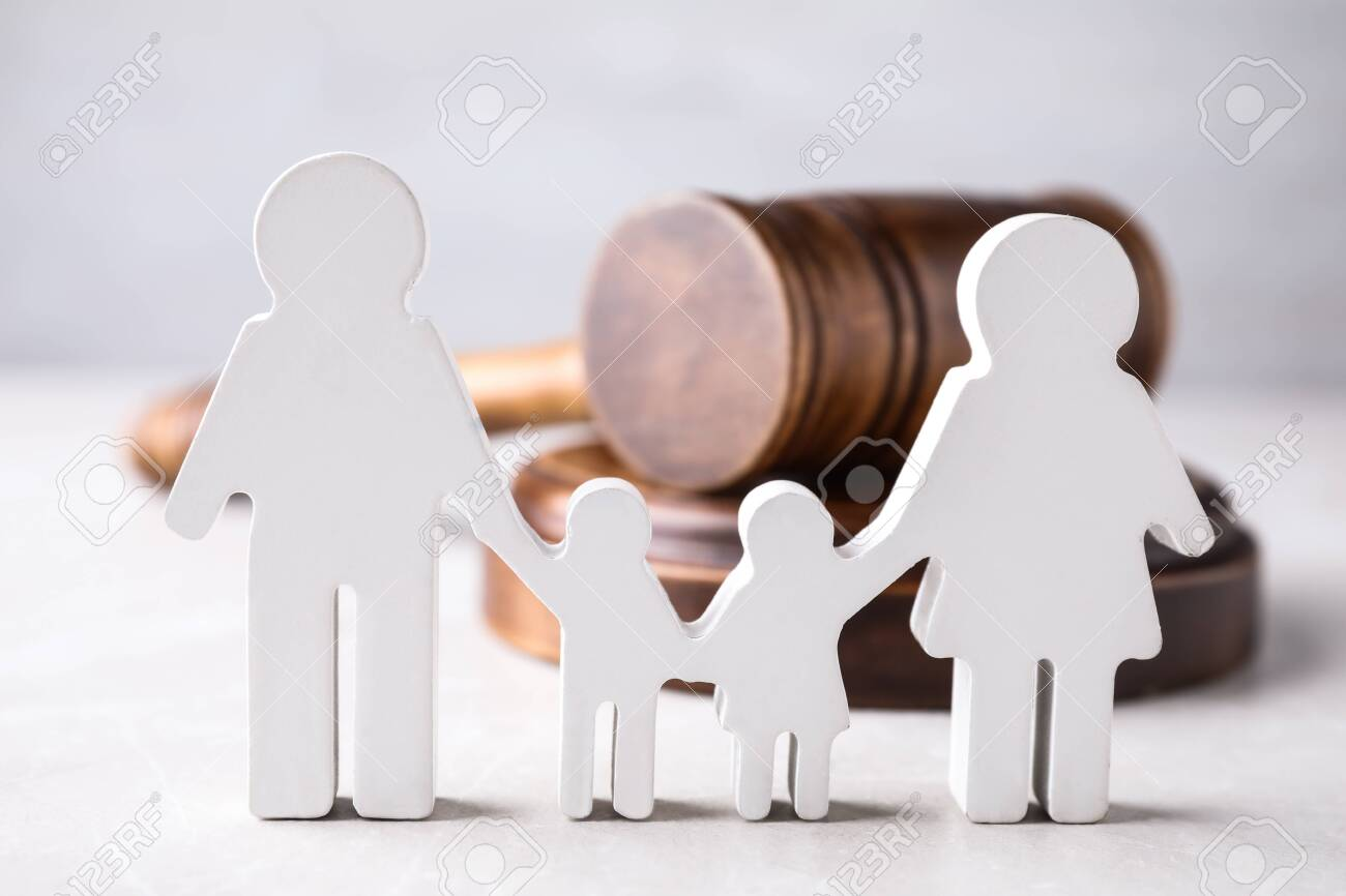Figure in shape of people and wooden gavel on light table. Family law concept - 133211717