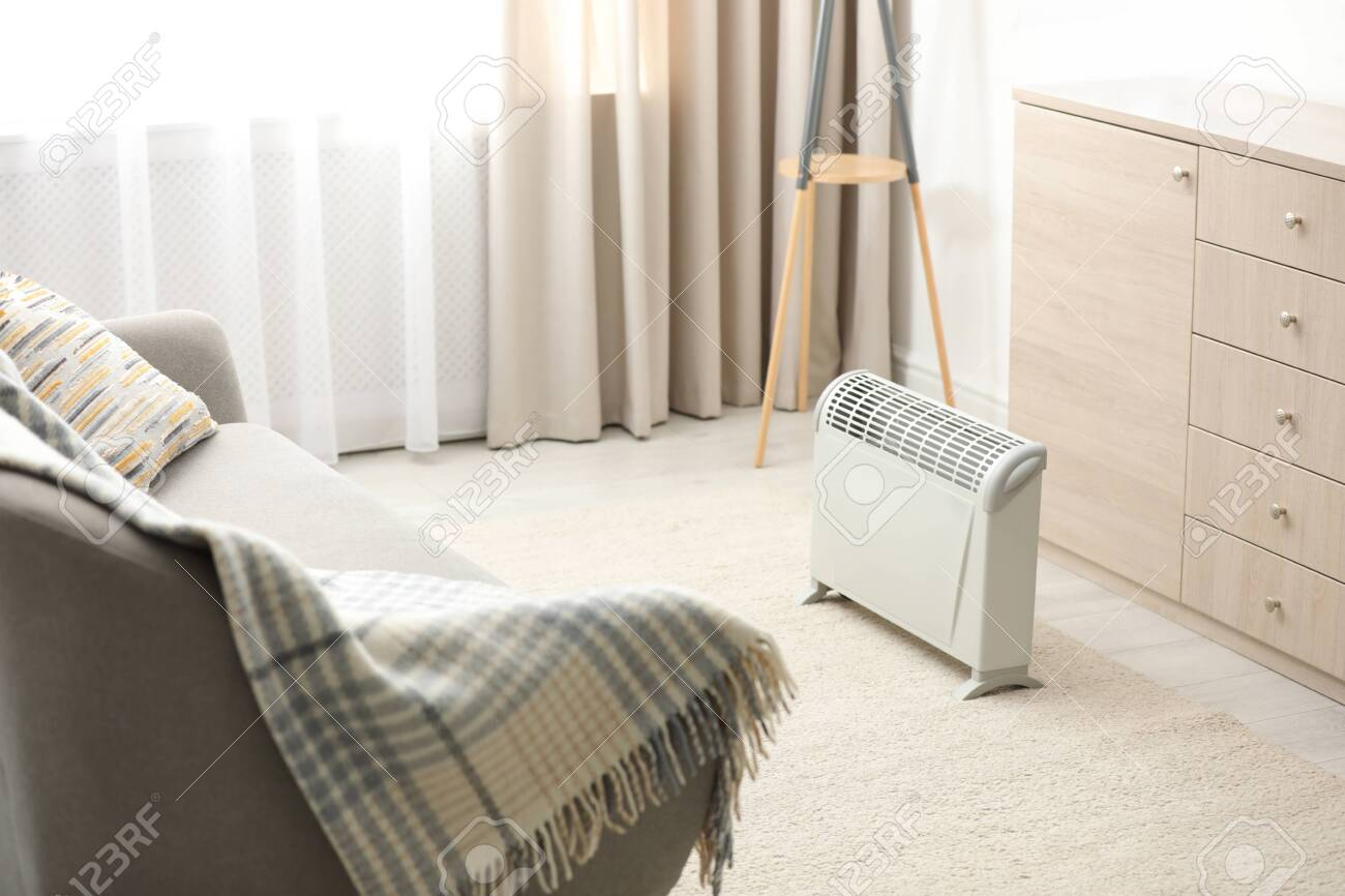 Modern electric heater in stylish room interior - 133321641