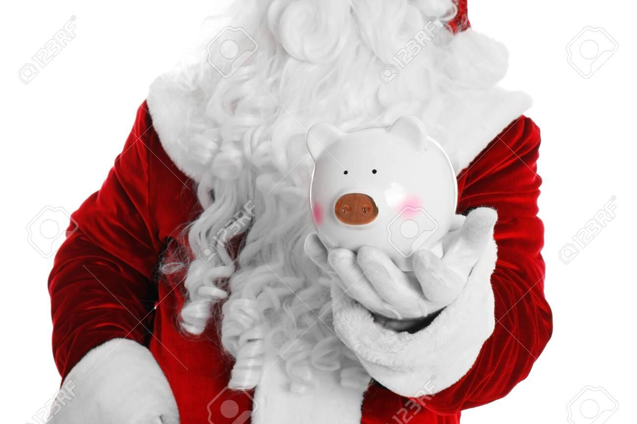 Santa Claus holding piggy bank on white background, closeup - 133321893