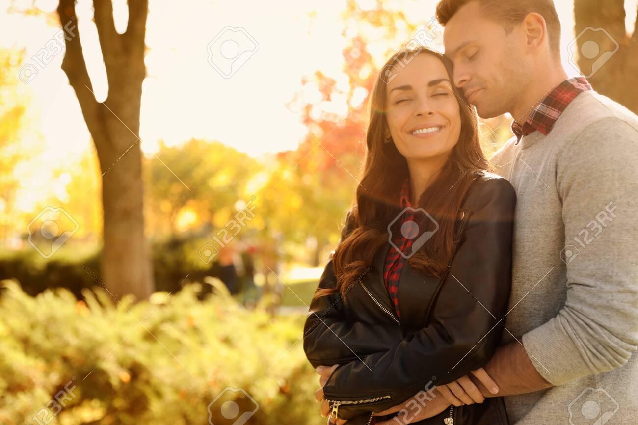 Happy couple in sunny park. Autumn walk - 133479331