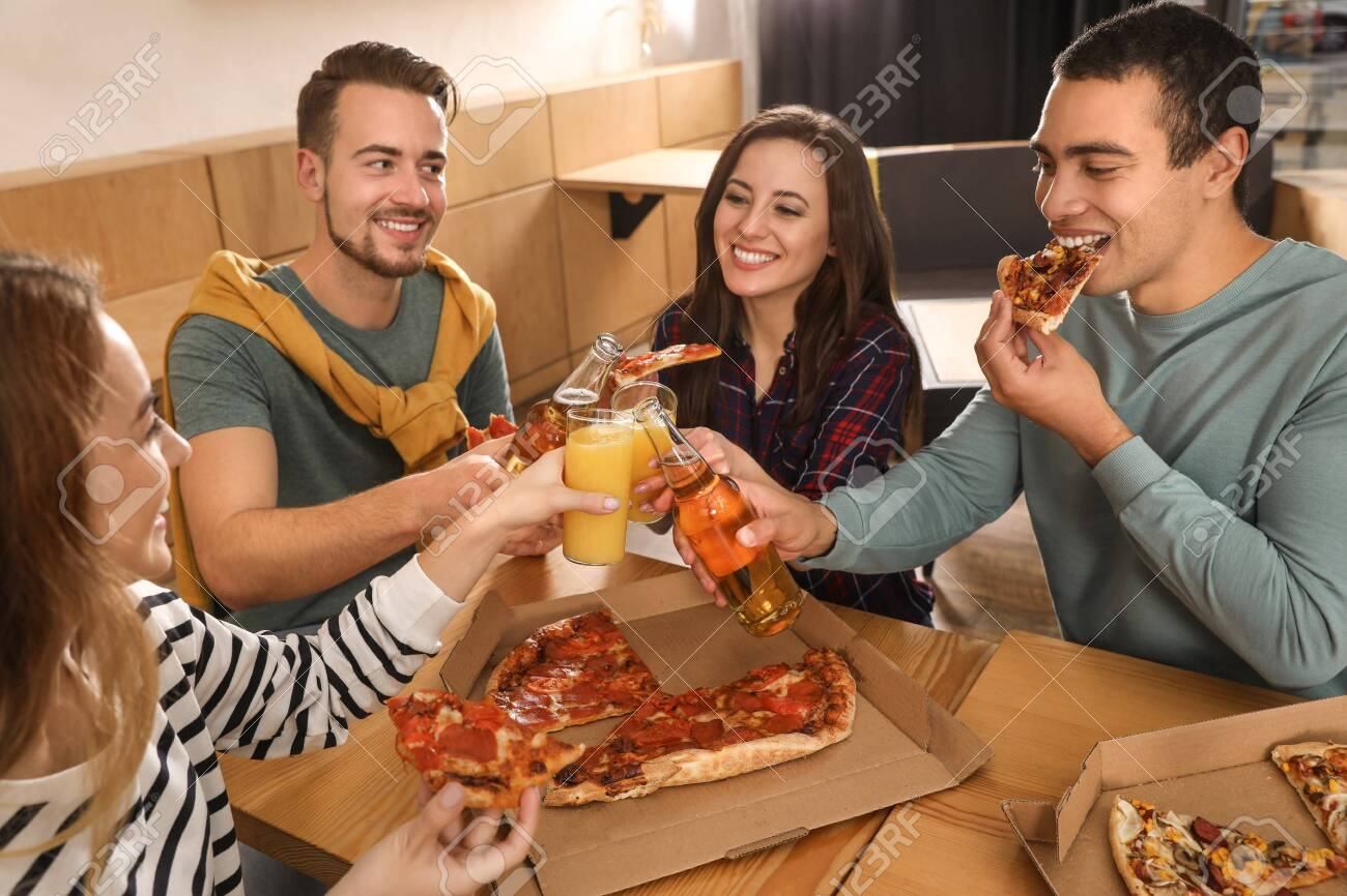 Group of friends having fun party with delicious pizza in cafe - 134236950