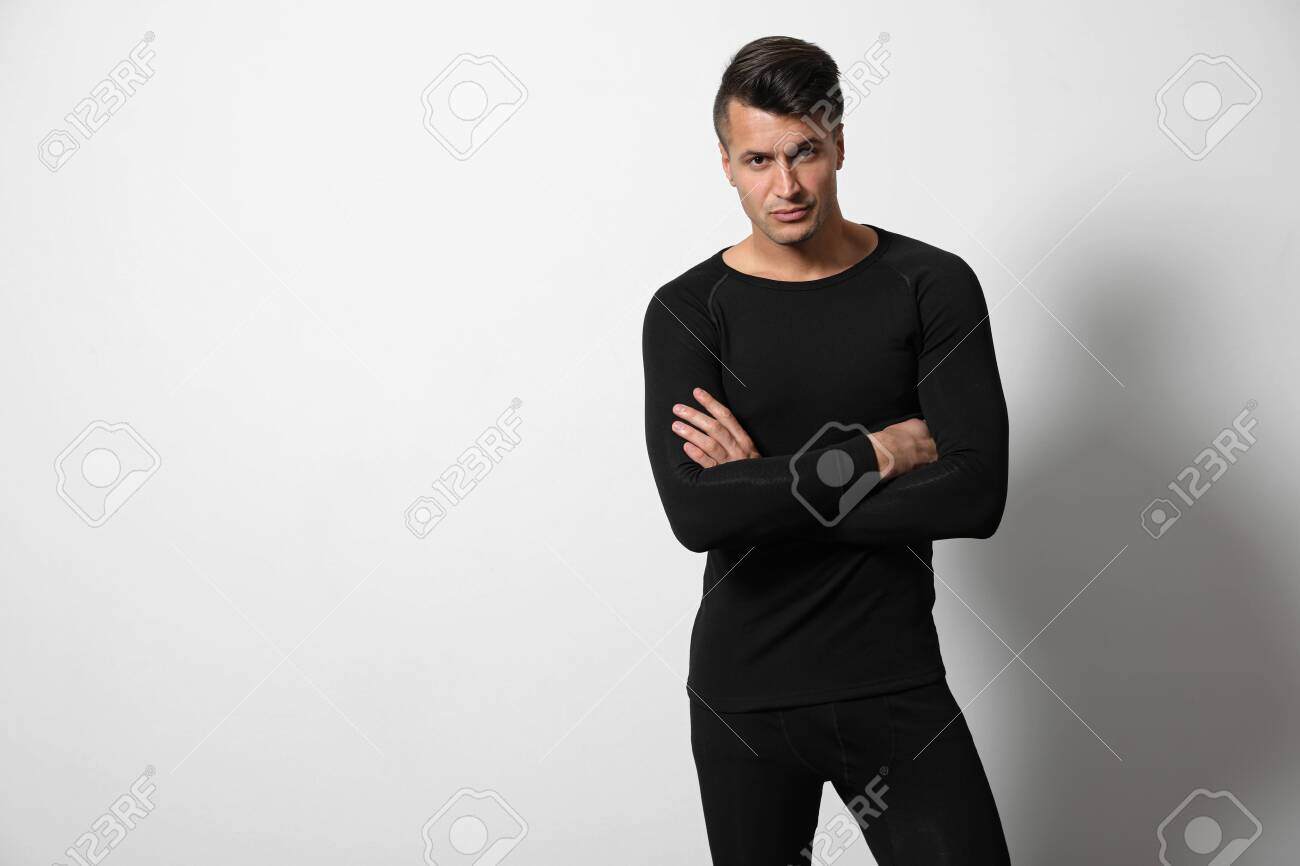 Man wearing thermal underwear on light grey background. Space for text - 135323755