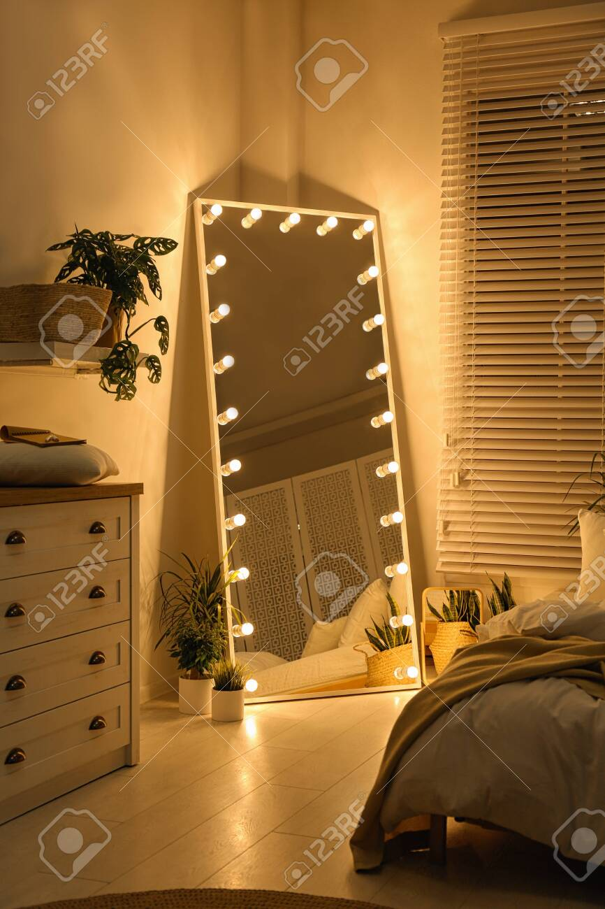 Stylish Mirror With Light Bulbs In Dark Bedroom Interior Design Stock Photo Picture And Royalty Free Image Image 135644696