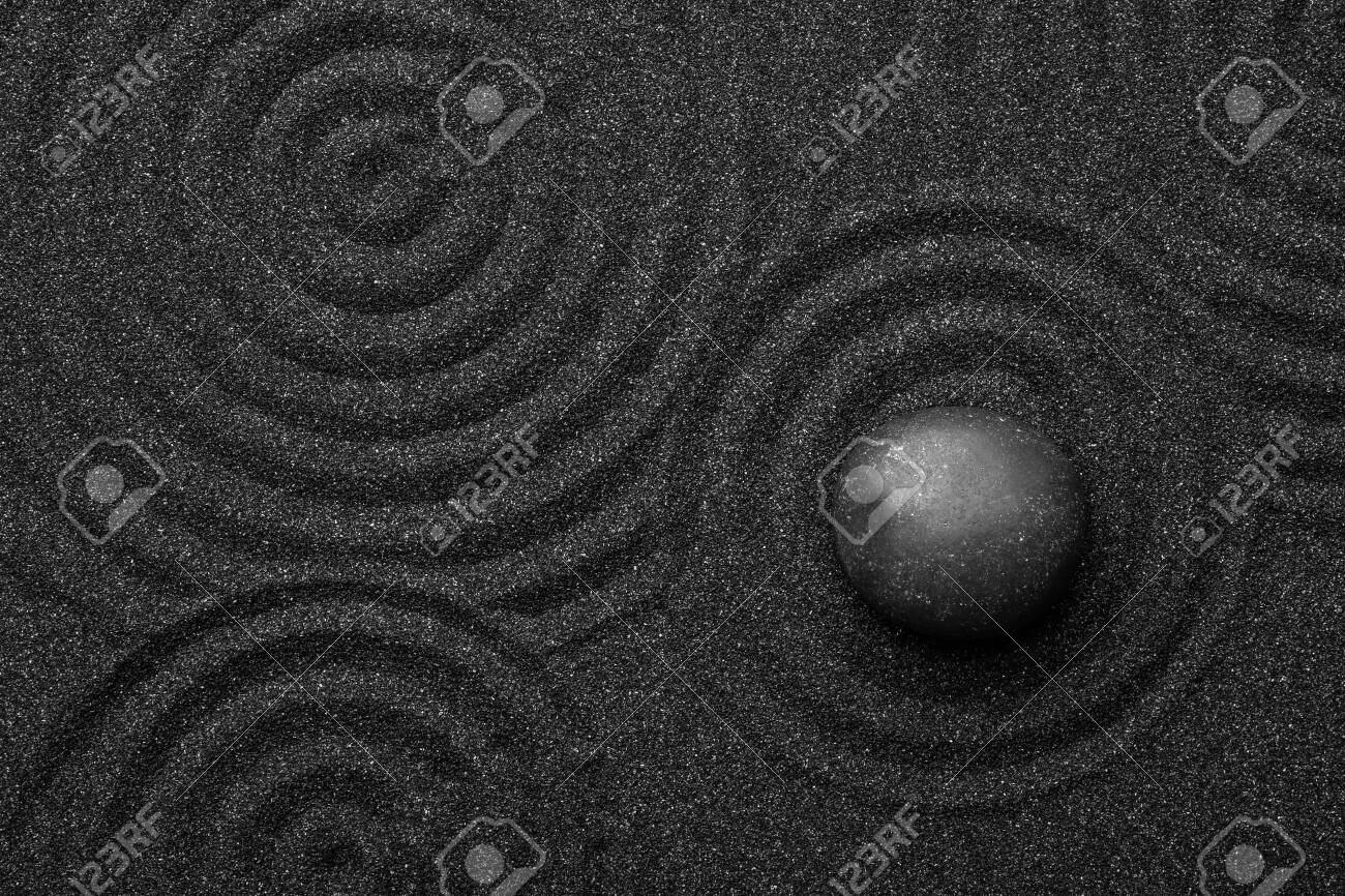 Black sand with stone and beautiful pattern, top view. Zen concept - 135951092