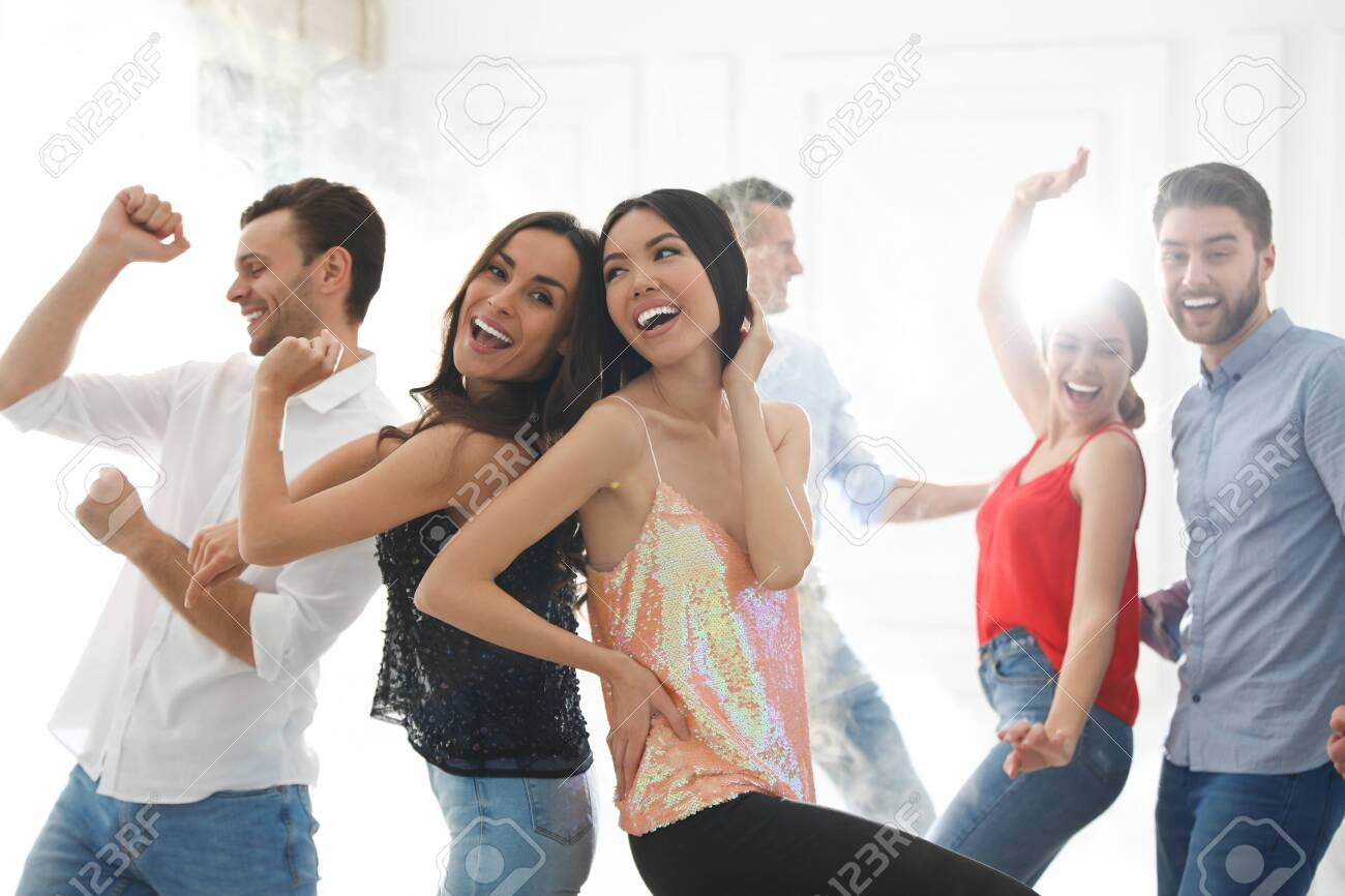 Couple of happy friends dancing at party - 137583677
