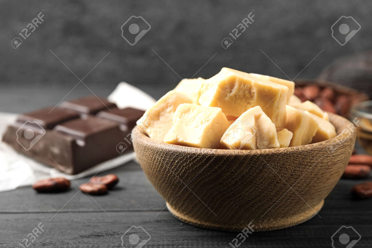 Organic cocoa butter on black wooden table, closeup - 137326151