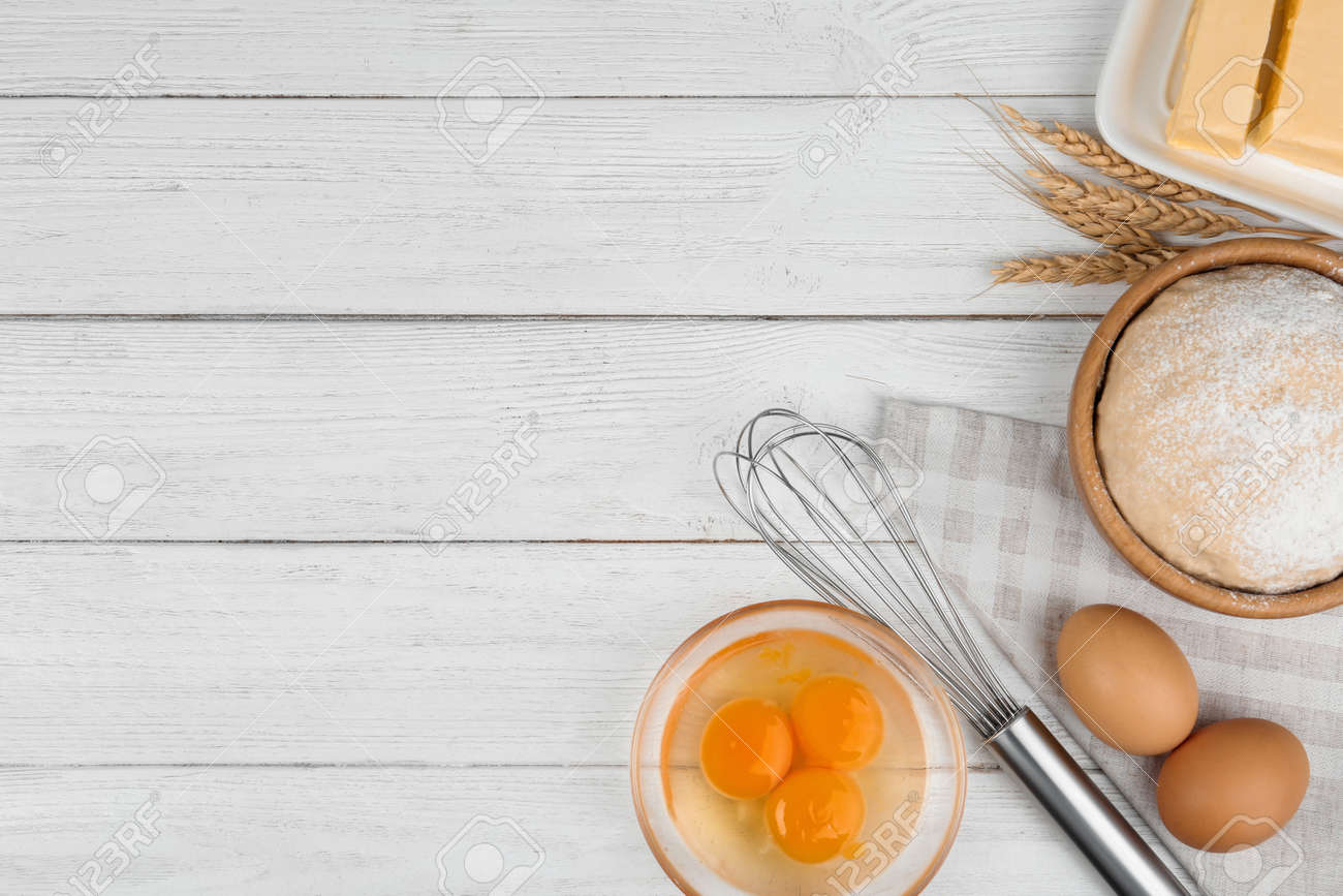 Flat lay composition with eggs and other ingredients on white wooden table, space for text. Baking pie - 137578696