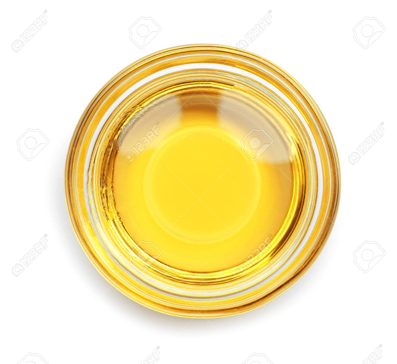 Cooking oil in glass bowl isolated on white, top view - 137772935