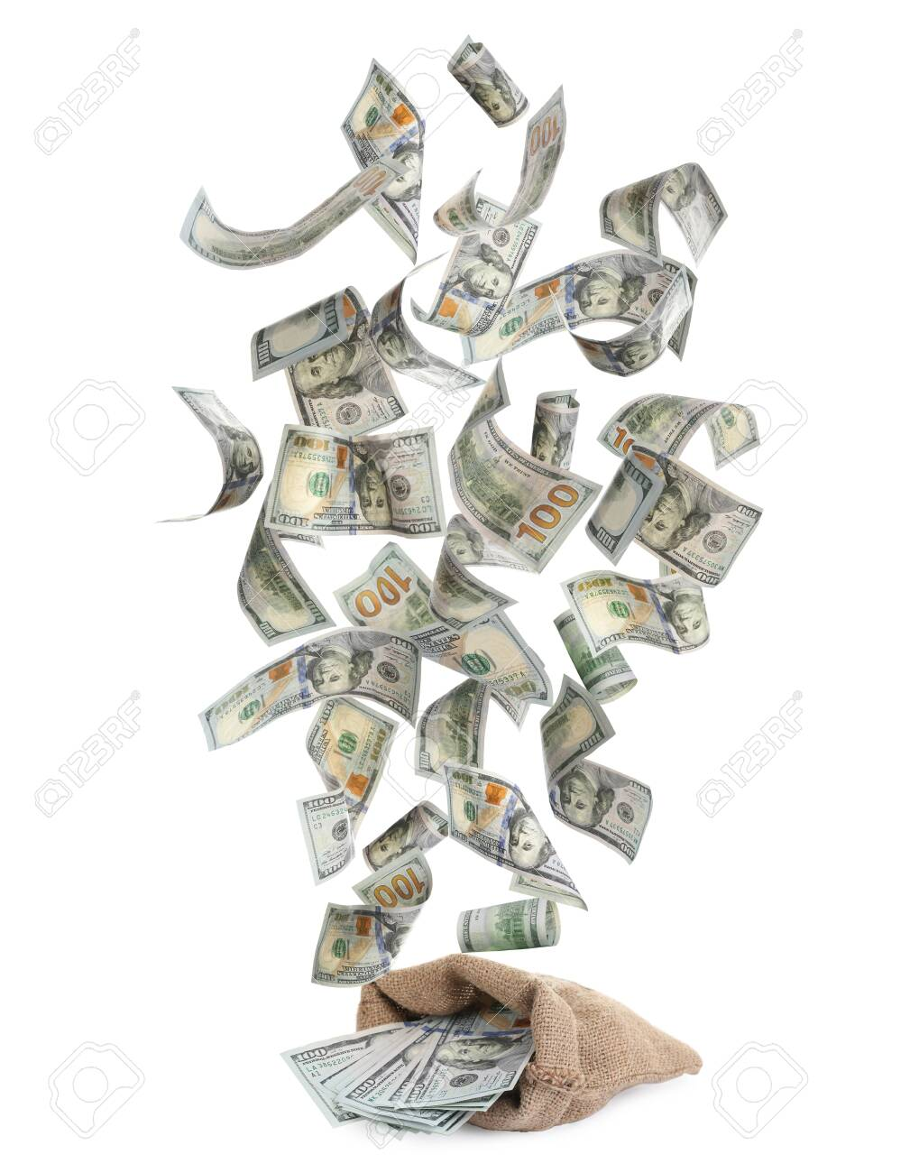 Sack and American dollars on white background. Flying money - 138540741