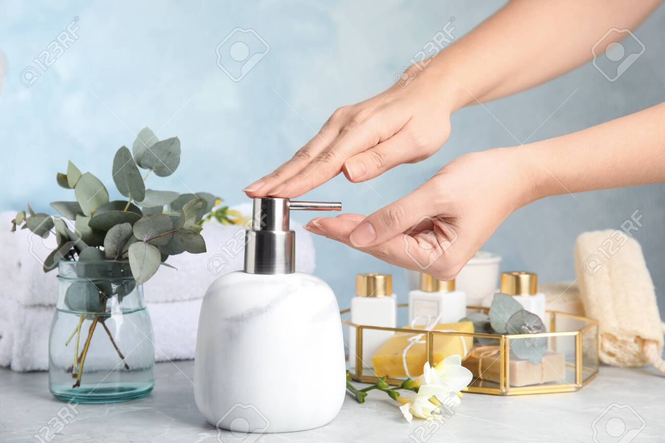 Woman using soap dispenser indoors, closeup view - 138730744