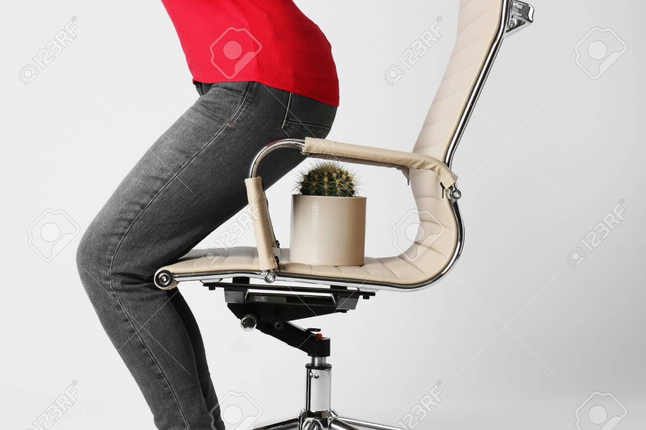 Woman sitting down on chair with cactus against white background, closeup. Hemorrhoids concept - 138904636