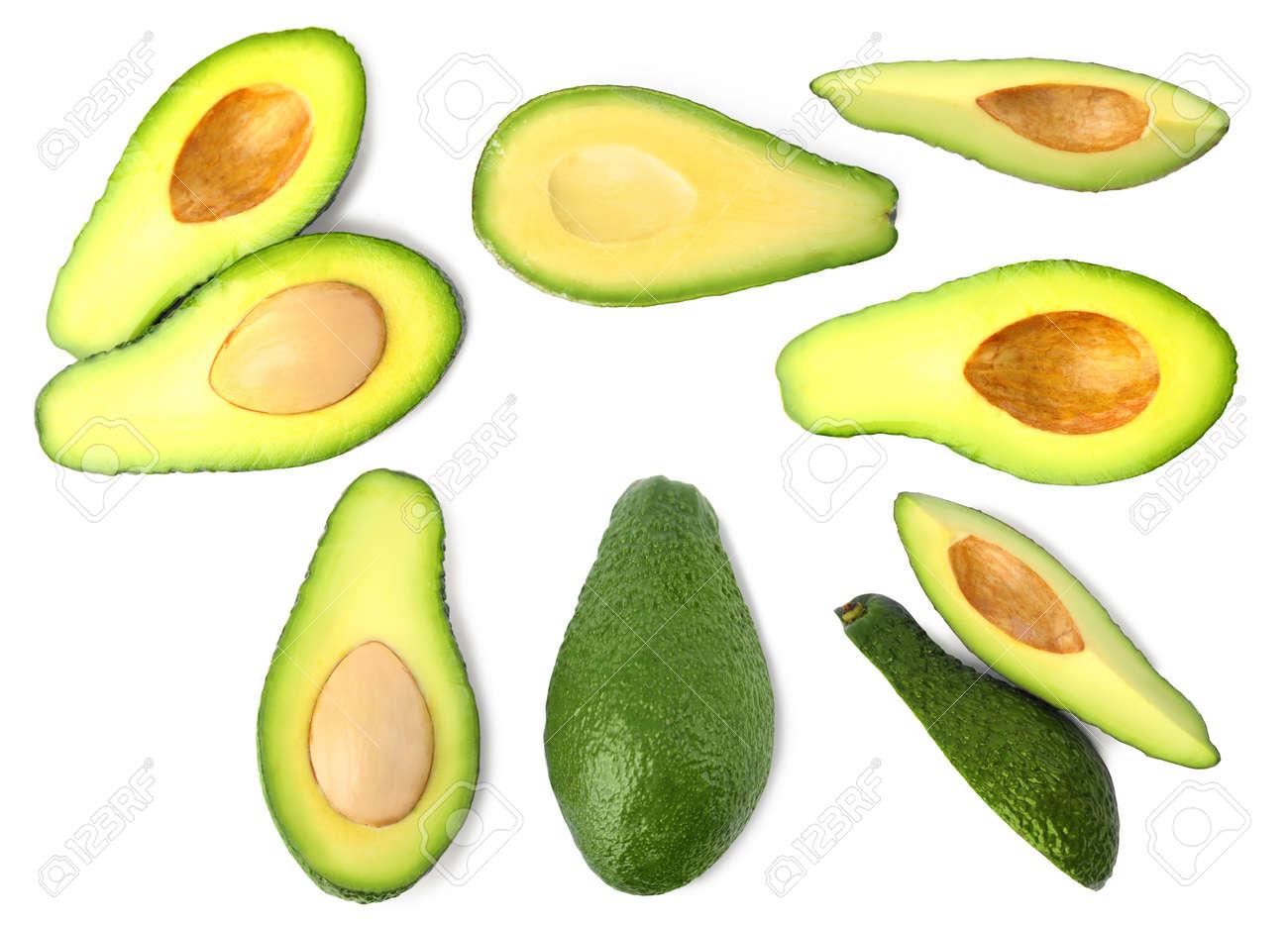 Set of delicious fresh avocados on white background - 139395264