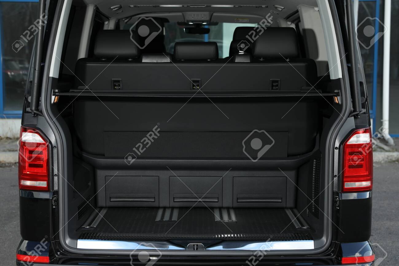 Modern car with open empty trunk outdoors - 139492272
