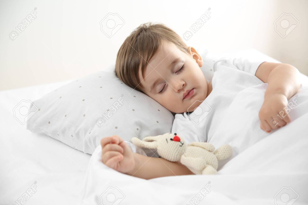 Cute little baby sleeping with toy at home. Bedtime - 140022613