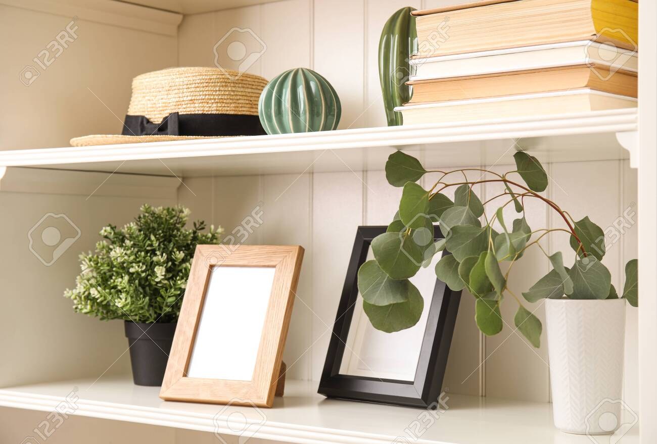 White Shelving Unit With Plants And Different Decorative Stuff Stock Photo Picture And Royalty Free Image Image 139925631