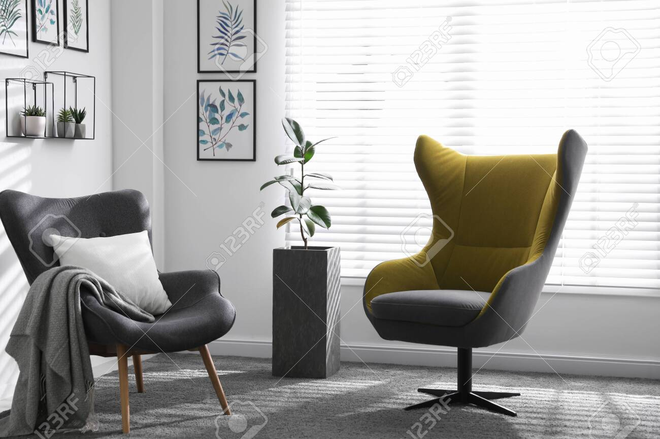 photo fortable armchairs near window in light room