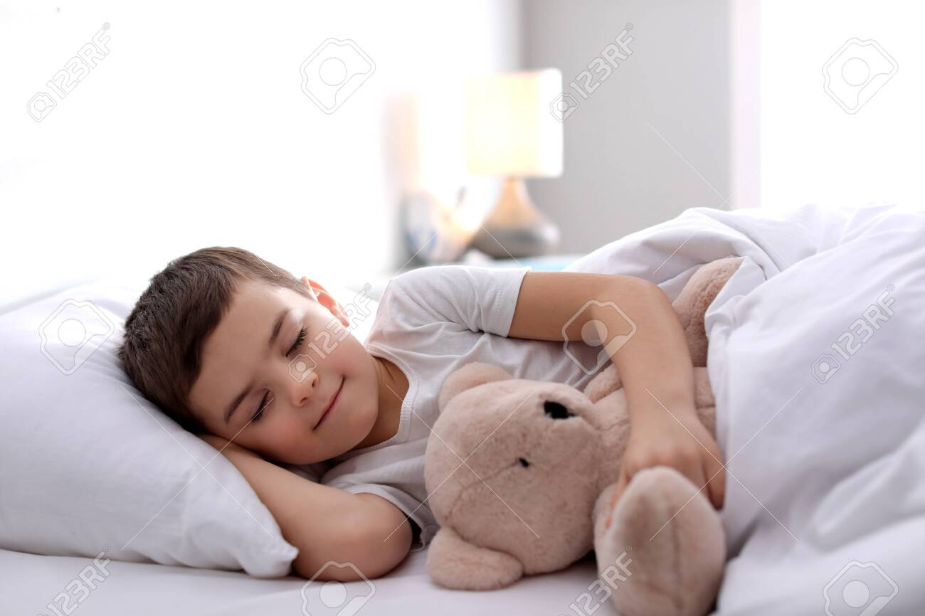 Little boy sleeping with teddy bear at home. Bedtime - 140894494