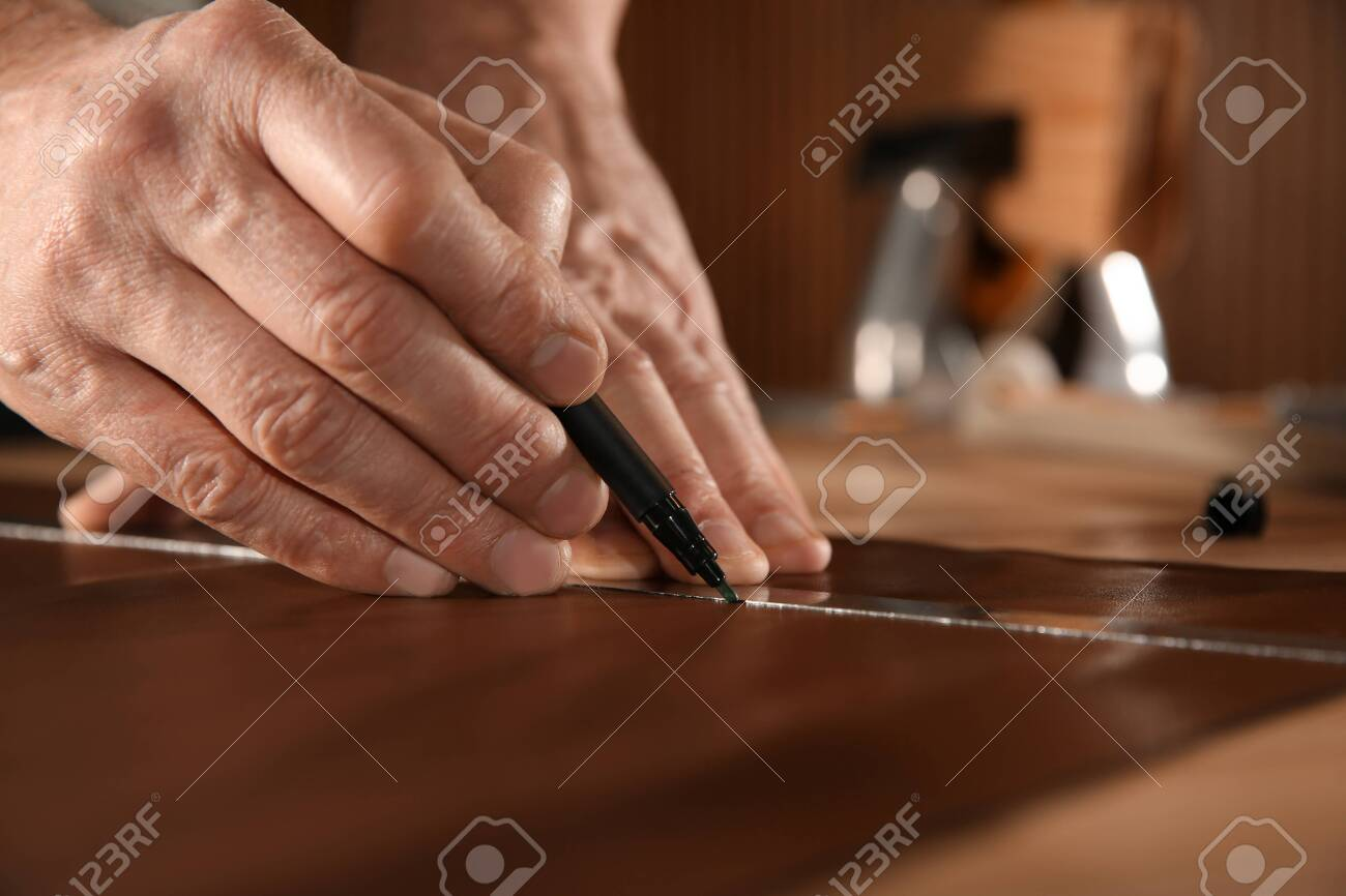 Man working with piece of leather in workshop, closeup - 140834195