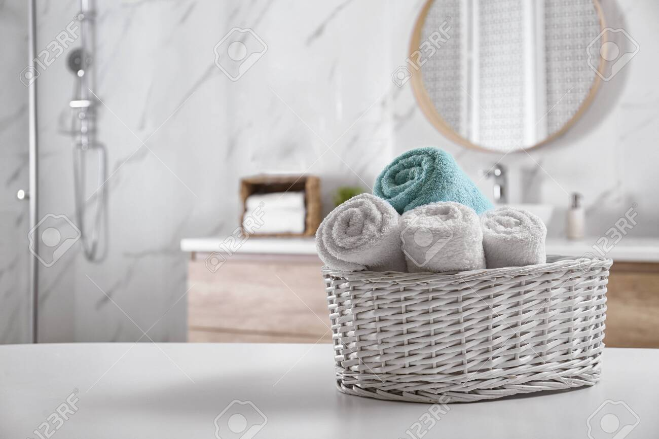 Wicker Basket With Clean Soft Towels In Bathroom Space For Text Stock Photo Picture And Royalty Free Image Image 141145457