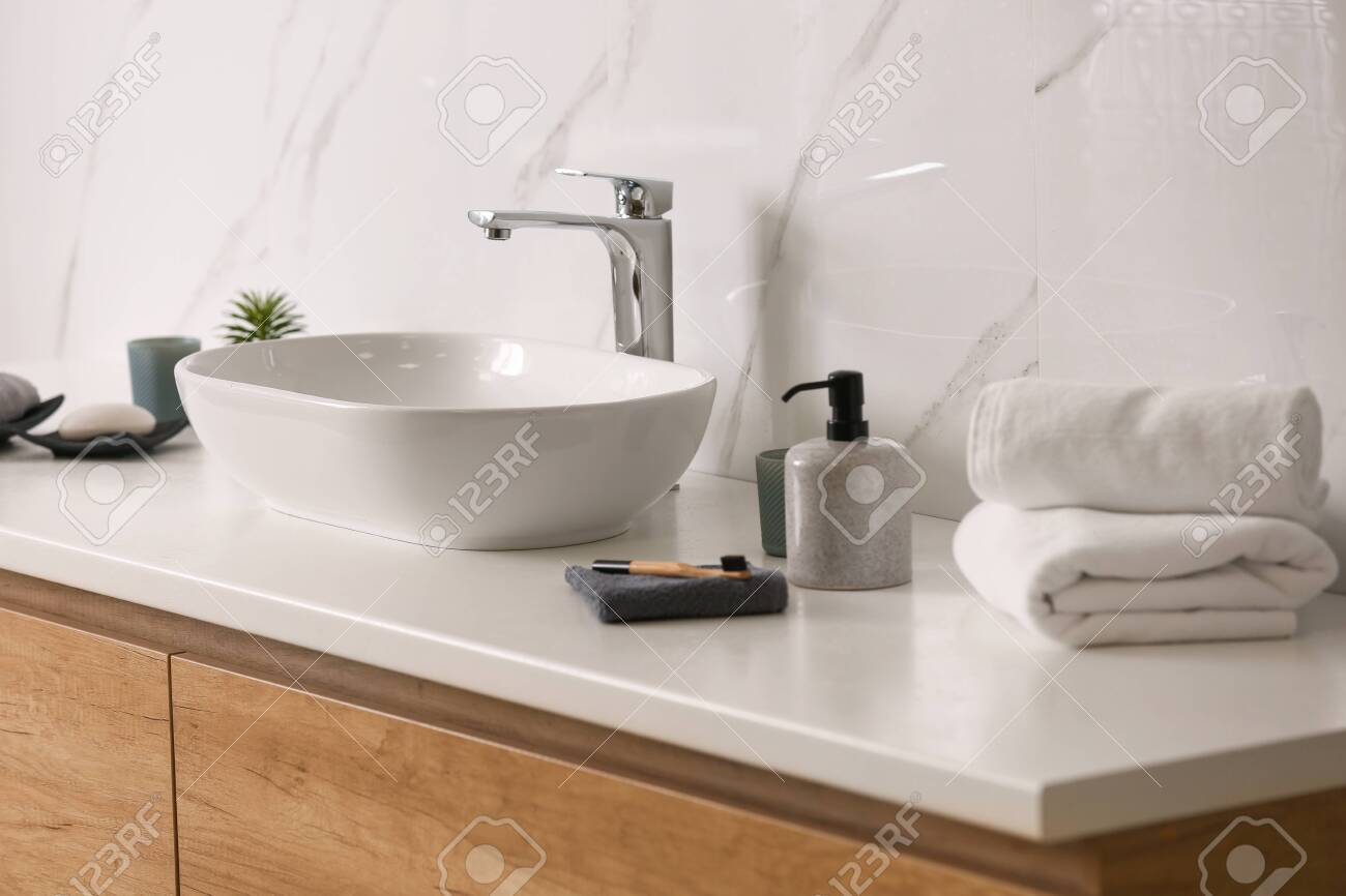 Toiletries And Stylish Vessel Sink On Light Countertop In Modern Stock Photo Picture And Royalty Free Image Image 141063119