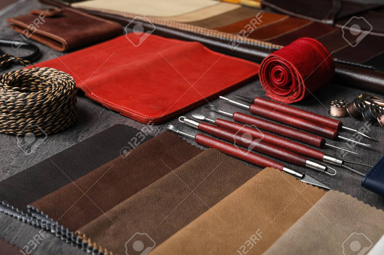 Leather samples and craftsman tools on grey stone background - 141372113