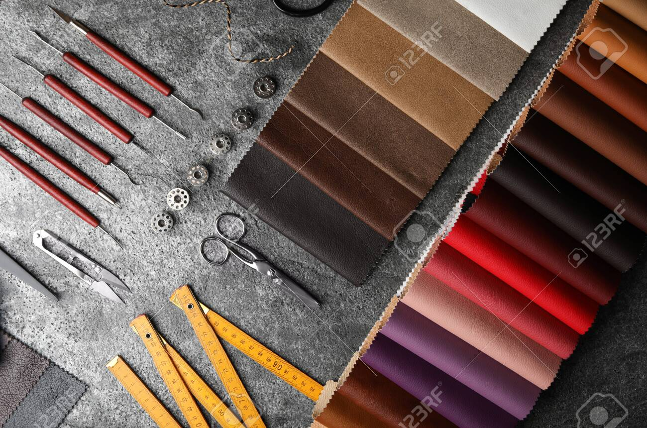 Flat lay composition with leather samples and craftsman tools on grey stone background - 141377434