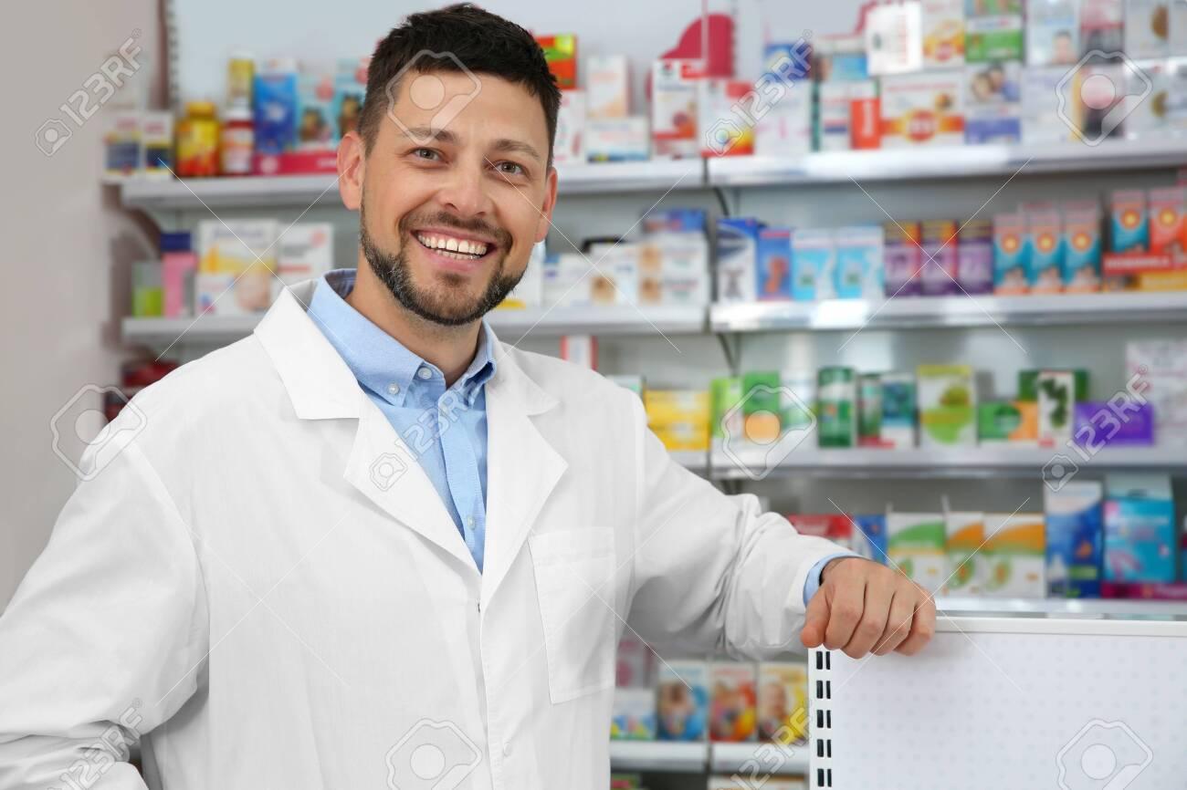 Portrait of professional pharmacist in modern drugstore - 141621293