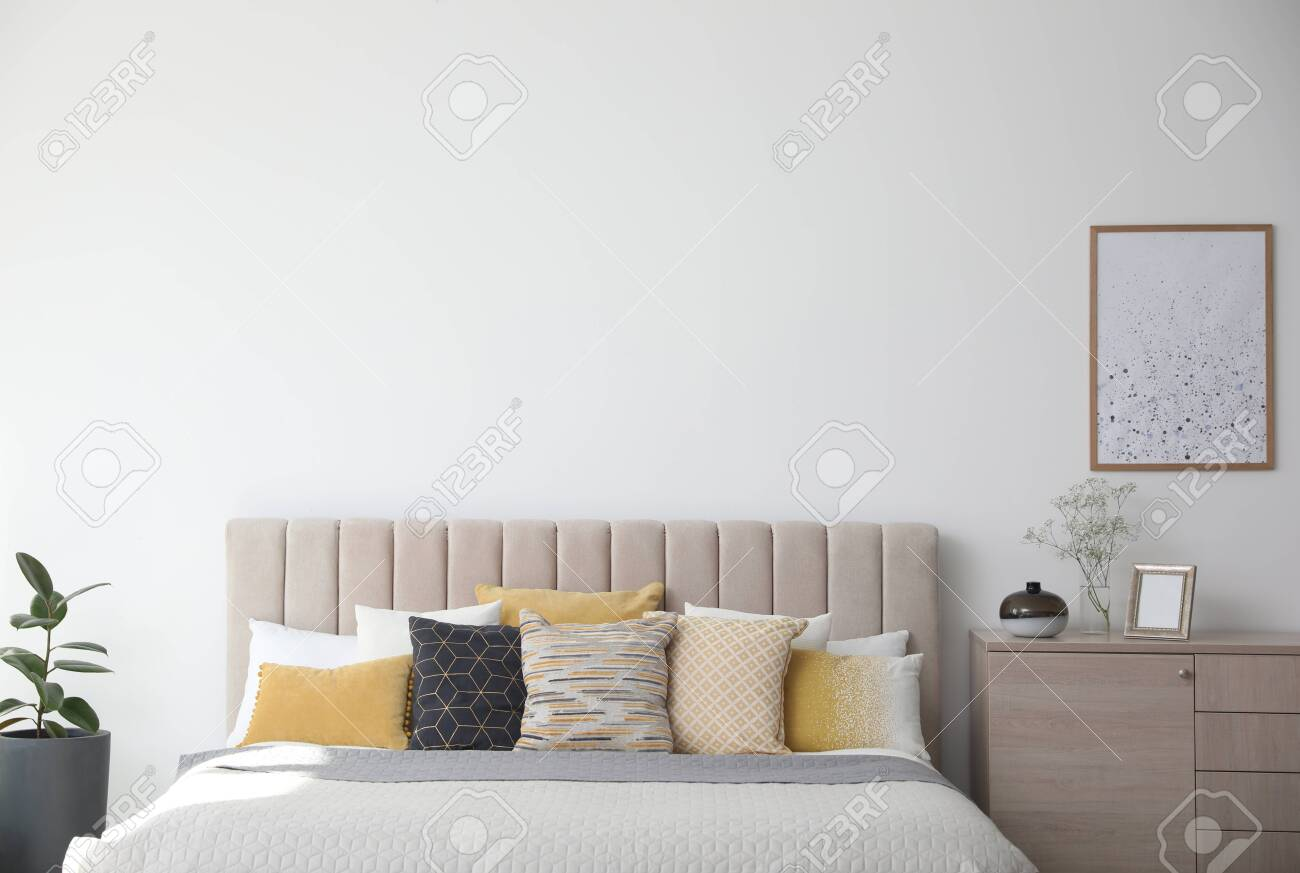 Stylish interior of contemporary room with comfortable bed - 141535225