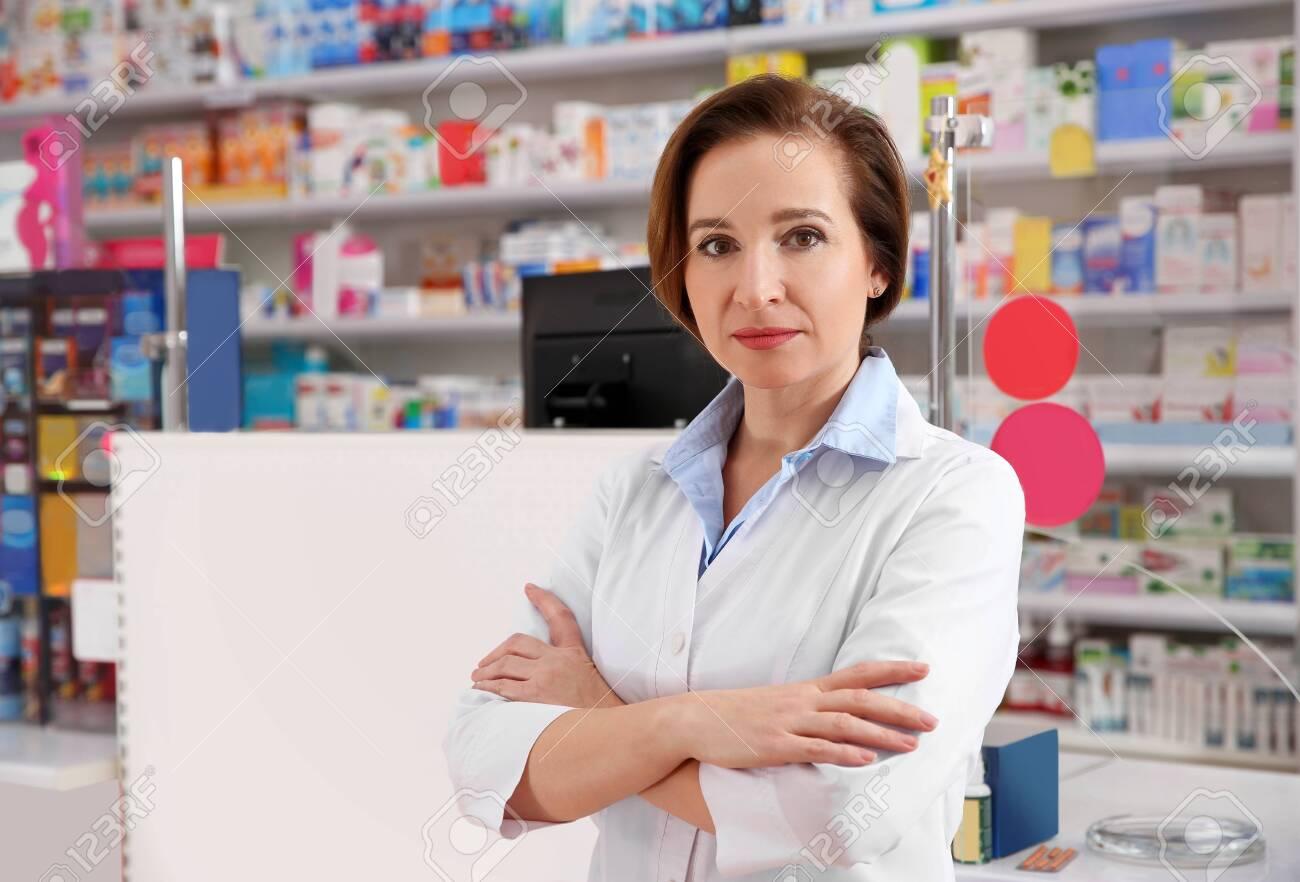 Portrait of professional pharmacist in modern drugstore - 141863170