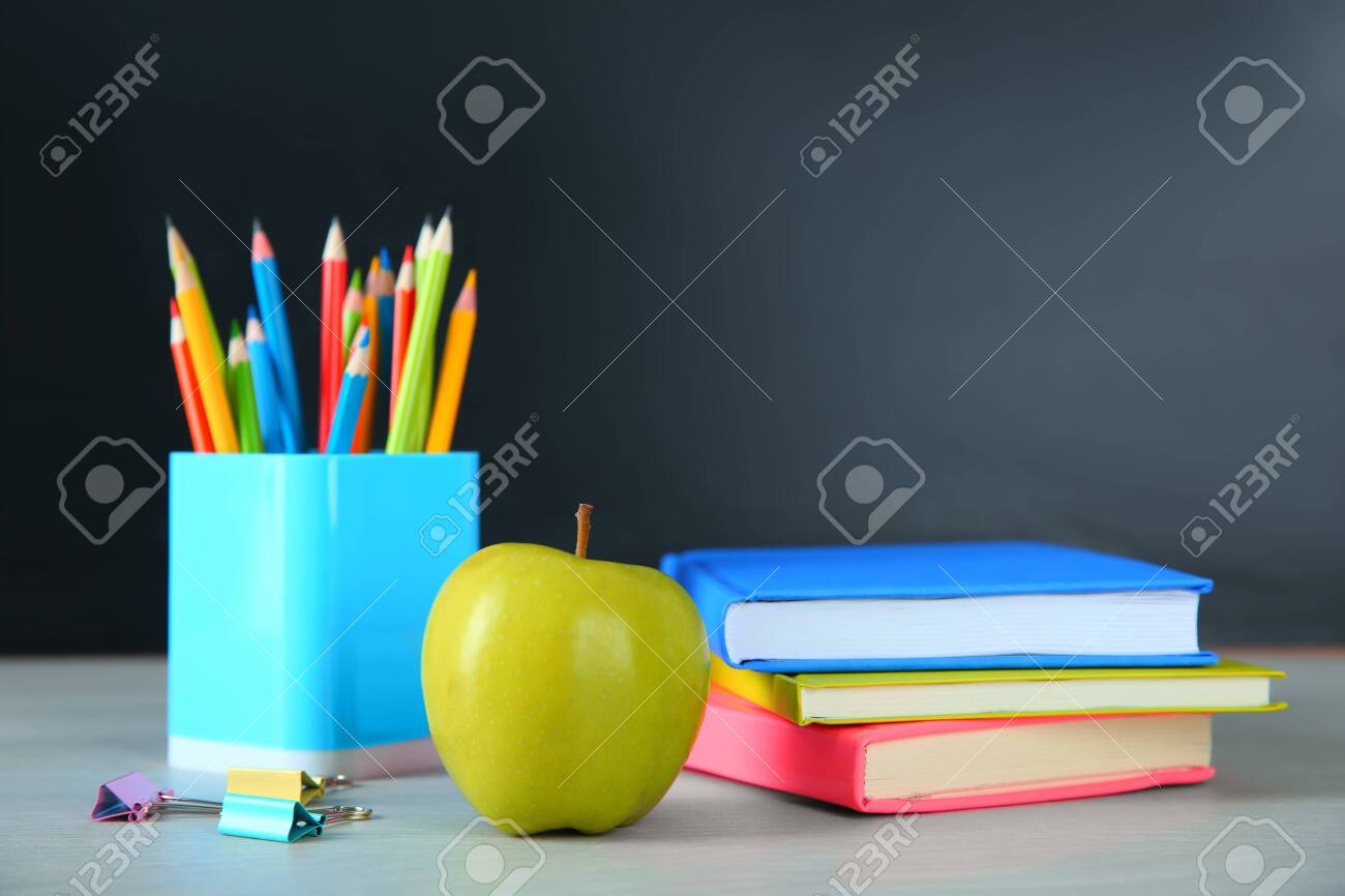 Apple and school stationery on white wooden table. Doing homework - 141766918