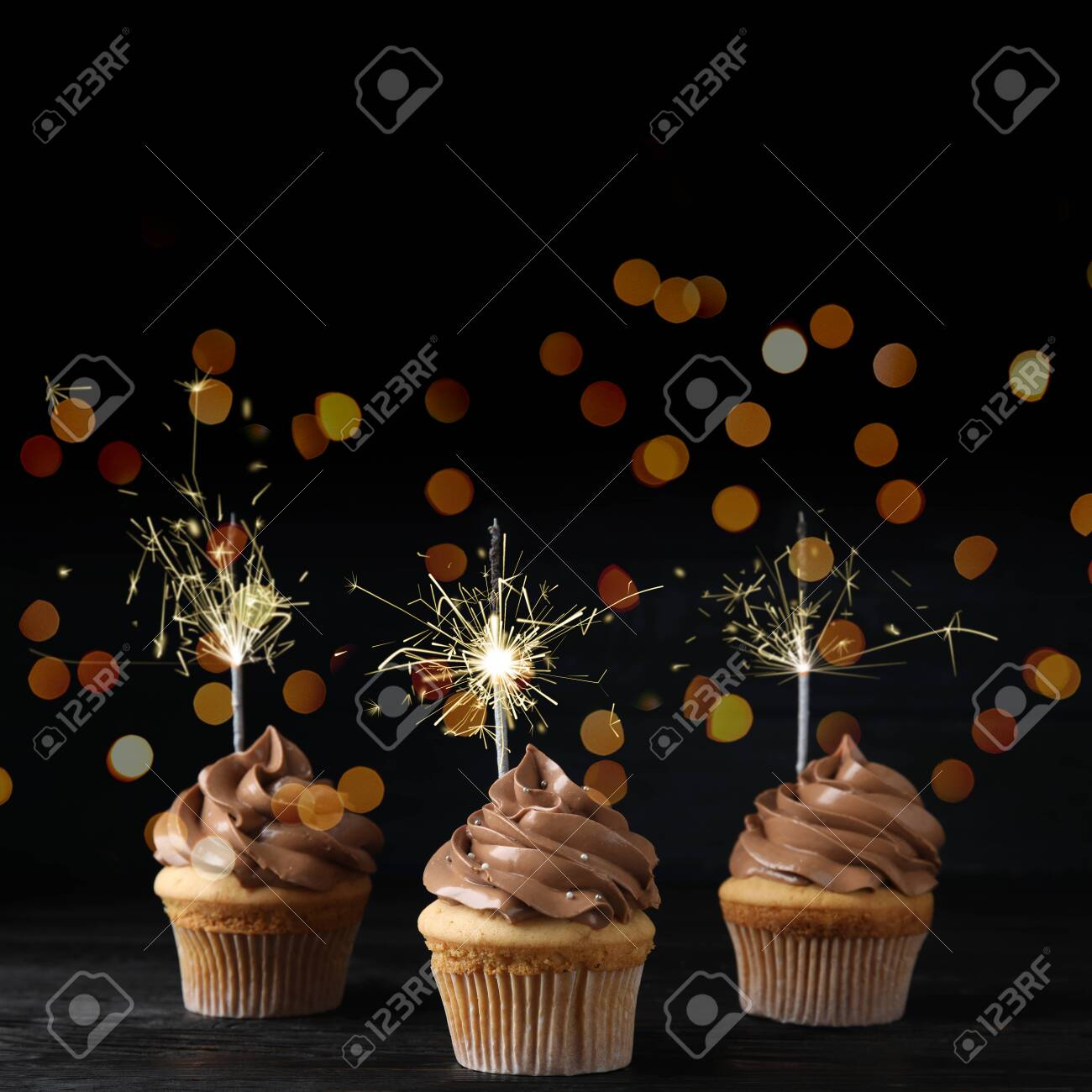 Fantastic Birthday Cupcakes With Sparklers On Wooden Table Against Dark Funny Birthday Cards Online Inifofree Goldxyz