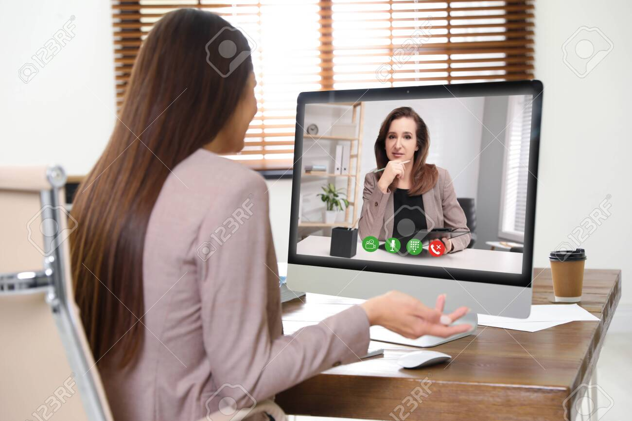 Woman using video chat for online job interview in office - 151775931