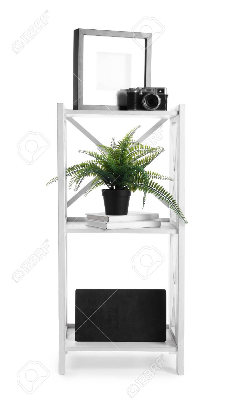Wooden Shelving Unit With Different Items Isolated On White Stock Photo Picture And Royalty Free Image Image 147570197