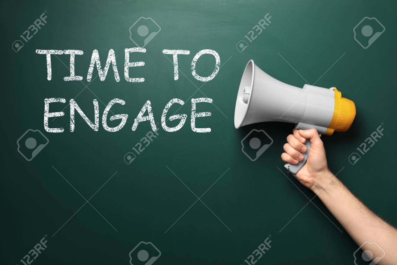 Man holding megaphone near chalkboard with text Time To Engage - 147848474