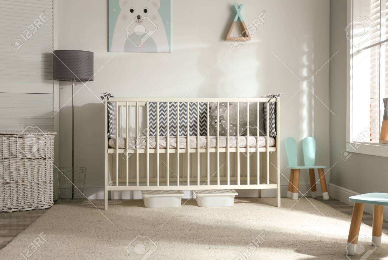 Cute baby room interior with crib and decor elements - 148066822