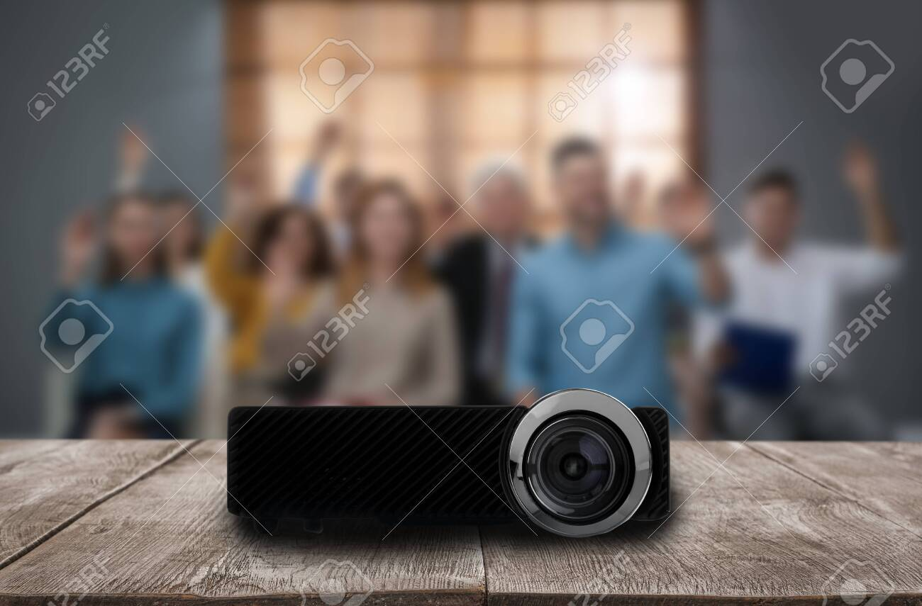 Modern video projector and blurred people on background - 150576729
