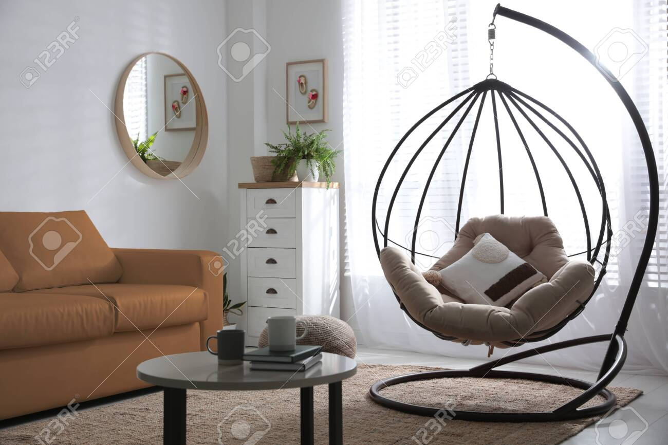 Stylish Leather Sofa And Swing Chair In Modern Living Room Interior Stock Photo Picture And Royalty Free Image Image 150250476