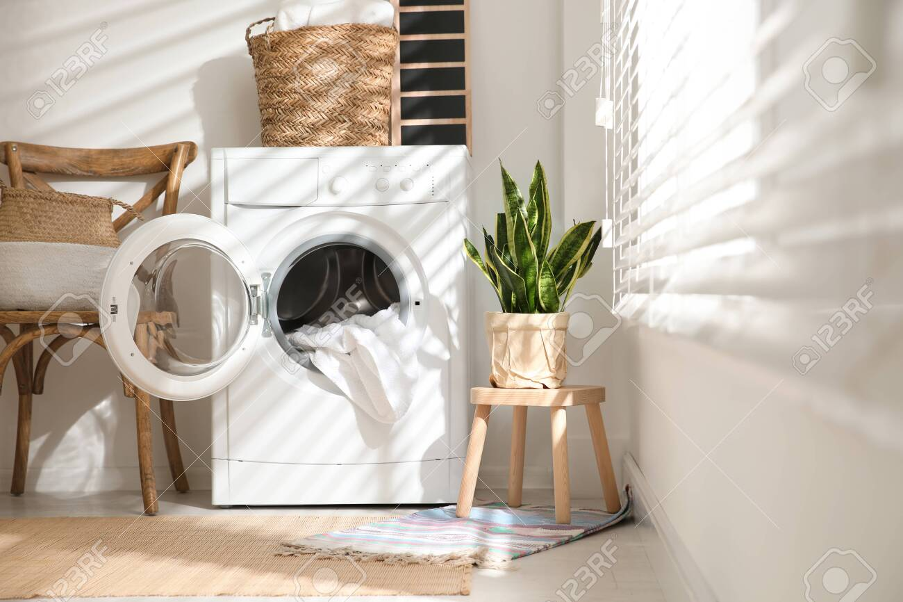 Modern washing machine in laundry room interior - 150251367