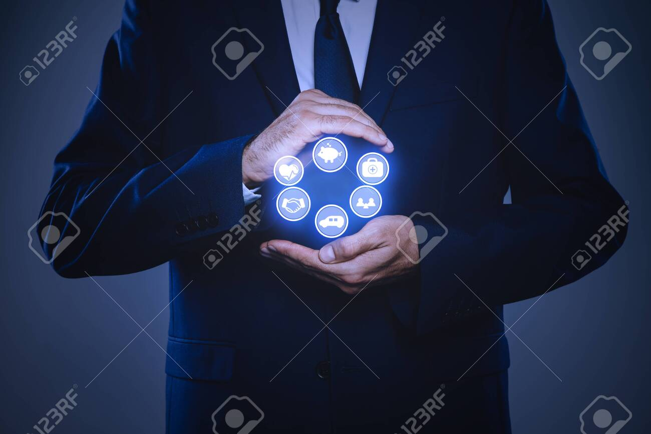 Businessman holding different icons on dark background, closeup. Insurance concept - 150500208