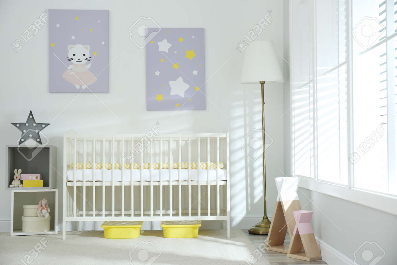Stylish baby room interior with crib and cute pictures on wall - 155500109