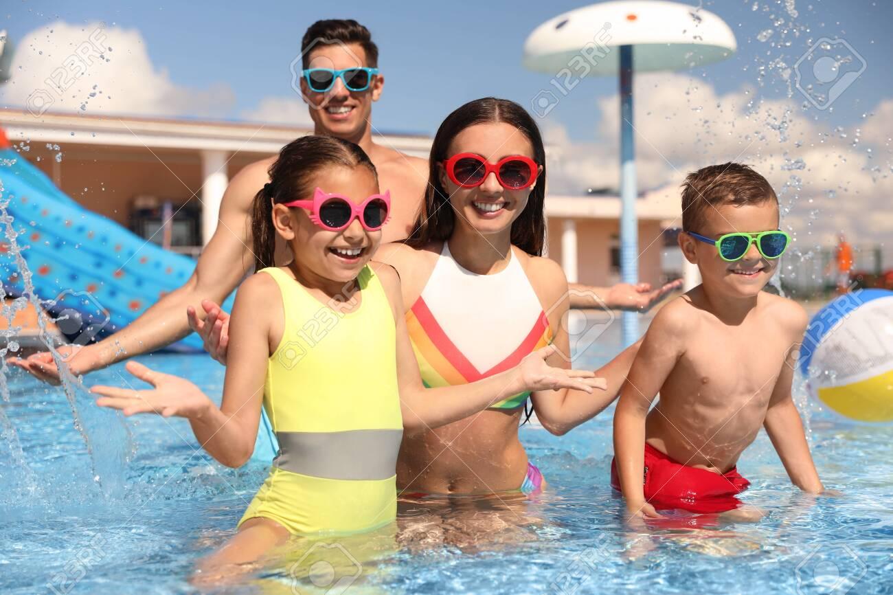 Happy family having fun at water park. Summer vacation - 154289767